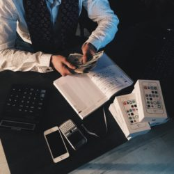 a photo of a business person counting money